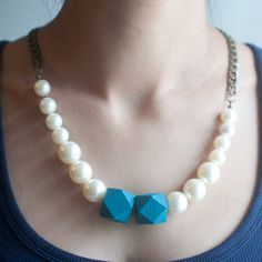 Check out this item in my Etsy shop https://www.etsy.com/listing/210488085/wooden-beaded-white-pearl-glass