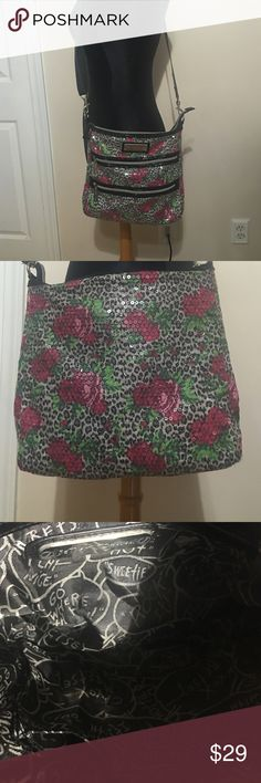 "Betsey Johnson cross body Messenger bag Betsey Johnson Cheetah Blossom Black 2 zip Cross Body XBody Messenger Bag.  sequin crossbody bag with zipper pockets at the front with adjustable shoulder strap. Features keychain holder and organization pockets inside.  Style Messenger & Cross Body Material Synthetic Bag Height :	11"" Bag Depth :	1"" Bag Length :	12"" Strap Drop :	22"" Betsey Johnson Bags Crossbody Bags"