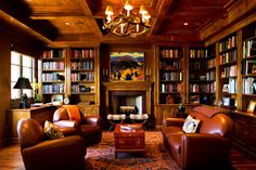 """Every dream home should have an amazing!!!! Library! Love the warmth of the room.... Needs a nice fluffy chenille throw across the back of the couch instead of the """"Granny"""" pillow and blanket"""