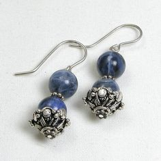 """Handmade gemstone sodalite earrings feature semi-precious sodalite round gemstones in sterling silver bead caps, and fishhook-style earwires. 1 1/4"""" in length. Add a necklace, pendant and bracelet to"""