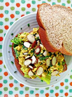 curried tofu salad with golden raisins and almonds, I am telling you TRY IT!!! I was addicted to curried tofu and raisins for a long time!! delish! Prob. one of my favorite meals!!