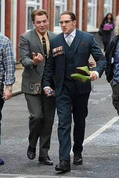"Taron Egerton with Tom Hardy on the set of ""Legend"""