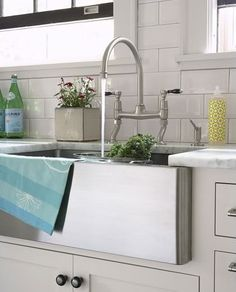A stainless steel farmhouse sink.