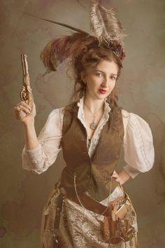 Model & Costume Designer: Tiffany Rae Knight Featured in Dark Beauty Magazine issue 19 #steampunk #teastain #smoke #gun #feathers #gold #brown #fashion #editorial