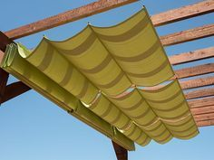 The wooden pergola is a good solution to add beauty to your garden. If you are not ready to spend thousands of dollars for building a cozy pergola then you may devise new strategies of trying out something different so that you can re Diy Pergola, Toile Pergola, Wooden Pergola, Outdoor Pergola, Pergola Kits, Pergola Roof, Cheap Pergola, Outdoor Shade, Pergola Lighting