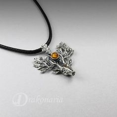 The Light Bringer silver stag pendant Baltic amber silver