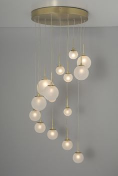 FROSTED SPHERES Inspired by art deco, the Kolding cluster pendant has pendulous frosted glass spheres that have subtle brass detailing. Christmas Lights Inside, Cluster Lights, Christmas Kitchen, New Home Designs, Lamp Shades, New Room, Home Lighting, Decoration, Home Improvement