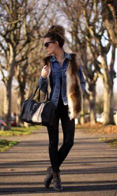 Great fur vest overtop a denim jacket & huge top knot - love.
