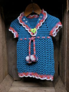 Hand Crocheted Baby Dress with Pom Poms by Maisymoocrochet on Etsy. £30.00, via Etsy.