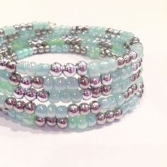 """Mint and silver """"mermaid"""" bracelet made at 11 year old birthday party in mississauga, ontario. All you have to do is provide a place to bead, we bring the beading party to you, we bring the beading supplies, the instructors and the fun. We specialize in children's birthday beading parties, but can customize our bead party to any event and/or occasion such as Bat Mitzvahs, corporate events, summer camps, school workshops, Girl Guides of Canada, wedding/bridal showers, bachelorette parties or…"""
