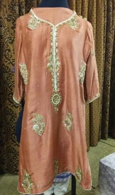 Code#003 Preloved 3 piece suit. Tea pink pure silk shirt with full hand embroidery. Pure silk shalwar with shiffon dupatta.  Condition 9/10.  For Rs. 3000/- only.