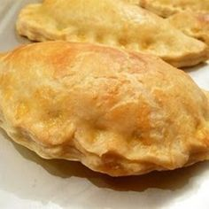 Forfar Bridies - A bridie is a savoury pie similar to a pasty, but is softer and made without potato, making it much lighter in texture. The filling is made of minced steak, butter, and beef suet seasoned with salt and pepper, and sometimes with an addition of minced onions. The filling is placed on rolled-out pastry dough which is then folded into a semi-circular or triangular shape and the edges crimped before it is baked in the oven.