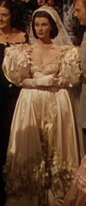Scarlett O'Hara wears her mother's wedding dress in Gone with The Wind when she hurriedly marries Melanie's brother, Charles Hamilton, after learning that Ashley plans to marry Melanie.