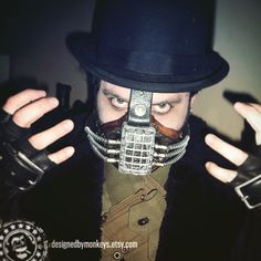 My steampunk Bane costume from 2012. I made the mask myself. #Batman #Bane #Halloween  I'll show off some better shots of the mask later. It was pretty but really unpleasant to wear for very long.  #comicbook #cosplay #costume #halloweencostume #steampunk #steampunkcostume #steampunkmask #steampunkbatman #batmanvillians #villian #villians #supervillians #halloweeniscoming #countdowntohalloween #passionproject #facebook #maskmaking #steampunkmaker #maker