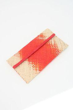 Pretty red/orange/coral on this woven raffia clutch.