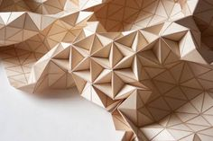 """Wooden Textiles – Turning wood into a fabric… The """"Wooden Textiles"""" series created by the German designer Elisa Strozyk, who imagines beautiful wooden blankets and carpets, born of a fascinating assemblage of small geometric pieces of wood… A subtle encounter between flexibility and rigidity, causing shifting and unusual shapes."""