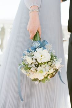 powder blue wedding dress and blue and white bridal bouquet shot by Alea Lovely