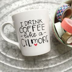Gilmore Girls. Enough said. ;)  This listing is for one white, high quality ceramic coffee mug with the handwritten words, I drink coffee