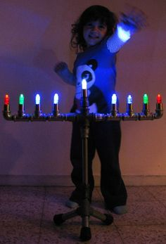 Israeli maker Avi Solomon was looking to provide his son Uriel with a maker angle on the Jewish holiday, Hanukkah. Together, they built a menorah out of steel pipe and LEDs. Hanukkah Crafts, Jewish Crafts, Hanukkah Decorations, Hannukah, Holiday Crafts, Hanukkah Menorah, Christmas Lights Inside, Christmas Trees, Jewish Festivals