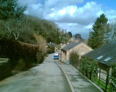 "25 May 2006.  View of Rose Row, looking eastward on Dovedale end of High Street.  These cottages face away from the road.  Right foreground is a portion of the former Dovedale Mill.   [""Blockley High Street,"" Vickivic site on Flickr - Photo Sharing!]"