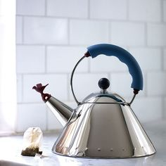 Whistling kettle by Michael Graves Picture this: after a lovely long, restful sleep, you're awoken gently by the sound of birdsong, followed by the delivery of a perfect morning cuppa. Bliss. Well, it's almost achievable with this stainless-steel singing kettle, designed in 1985 for iconic company Alessi by American architect Michael Graves.