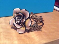 Butterfly bronze filigree bangle bracelet with a polymer clay rose