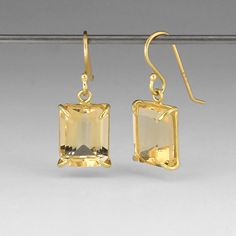 "18k yellow gold, small emerald cut citrine. Earrings measure 3/4"" long and are 3/8"" wide."