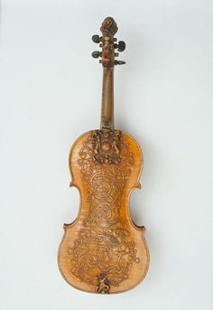 Violin Agutter, Ralph (attributed to, maker) ca. 1685  Carved, sawn and planed sycamore and pine This violin would have been made for the Royal Household either late in the reign of Charles II or during the reign of James II. The ornate carving on the back ould have been highly fashionable at about this time, and it includes the Royal Stuart coat of arms before the royal arms were modified at the time of the accession of William III and Queen Mary in 1688.