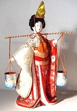 Japanese Hina doll - Japanese traditional dolls are known by the name ningyō in Japan, which literally means human shape. There are various types of Japanese dolls, some representing children and babies, some the imperial court, warriors and heroes, fairy-tale characters, gods and (rarely) demons, and also people of the daily life of Japanese cities.