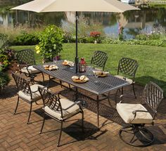 The Heritage Dining Set Features Outdura Fabric Cushions And A Solid Cast Aluminum Base Available