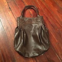 Brown bag Preloved faux brown leather bag only used to hold socks. One strap had dents from two hooks it was hanging on but the bag is still full functional. No rips tears or stains. Smoke free home. Zippered pocket inside magnetic snap to close the entire bag. Tags still attached. Bundling available. Kirra Bags Shoulder Bags