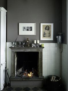 fireplace with tiled wall