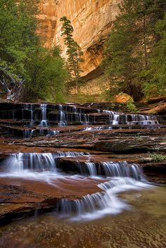 This Zion National Park waterfall picture depicts a spring cascade flowing over red bedrock in the Left Fork River. Places Around The World, Oh The Places You'll Go, Around The Worlds, Beautiful Waterfalls, Beautiful Landscapes, Zion National Park, National Parks, All Nature, Parcs