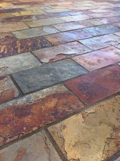 Colorful and rich slate tile with copper accent colors. By Scarlett's Landscape, Inc. http://scarlettslandscaping.com/