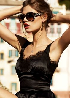 Dolce Gabbana black lace dress and dark sun glasses. Its a gorgeous style.