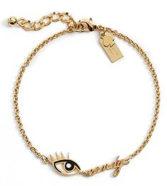 The arm candy becomes eye candy with this quirky-cute Kate Spade bracelet, featuring a flirty swarovski crystal-studded eye and elegant golden script.