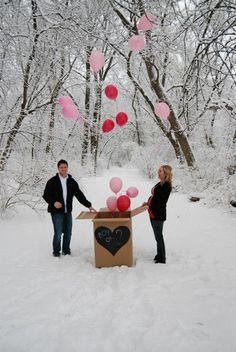 Gender reveal with balloons...I love how its in the snow!!