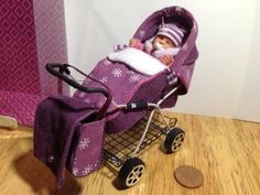 dolls house ooak sculpt baby Girl and Aubergine/snowflake Print Pram 1/12 scale