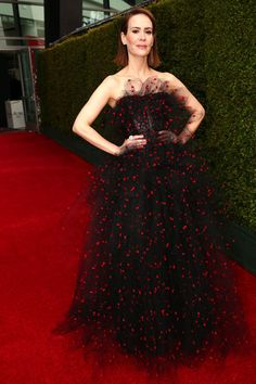 """The Best Dressed Celebs At The Emmys #refinery29  http://www.refinery29.com/2014/08/73361/emmys-2014-best-dressed-red-carpet-celebrities#slide19  From the same collection where we had a bit of a """"is this real life?"""" moment, Sarah Paulson chose an Armani Prive gown studded with a thousand magical stars that floated around her."""