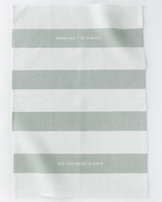 Love Stripe Tea Towel from Studiopatro. All you need is love and love is all you need. LOVE the phrase on this pretty, striped towel.
