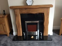Rustic waney edge oak beam fireplace made from air dried railway sleepers. Oak Beam Fireplace, The Rest Of Us, New Living Room, It's Amazing, Solid Oak, Fireplaces, Beams, Decor Ideas, House Design