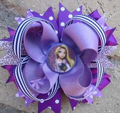 Disney Rapunzel Custom Boutique Hair Bow. $9.99, via Etsy.