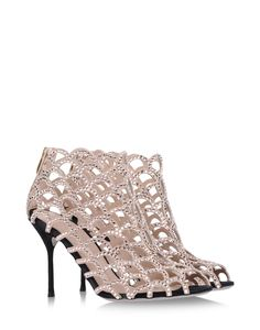 f5129ca17e568 Sergio Rossi's icon, the Mermaid sandal is laser cut to form the fish-scale
