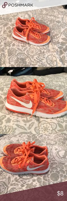 Nike Orange Running Shoes 8 Great shape. Wear shown in pic. Were my daughters she outgrew. Nike Shoes Athletic Shoes