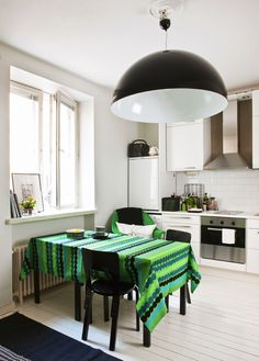 nice kitchen- love the fabric they used to the tablecloth