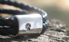 Leather bracelet with a silver pearl that shows an actual dog paw print - this was a memorial piece for a dog that left a big hole in our hearts.