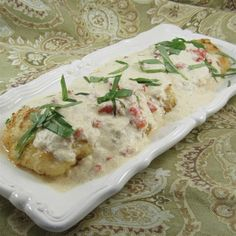 "Chicken In Basil Cream I ""This recipe is a welcome change from the usual fried chicken. The cream sauce gives it a wonderful flavor."""
