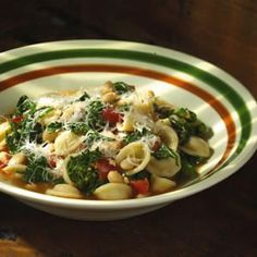 A healthful combination of beans and greens makes this pasta dish evocative of the Italian countryside. By dropping the greens in the boiling water with the pasta, you've eliminated an extra step, and an extra pot to wash.