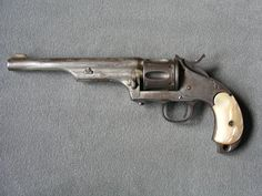 """44-.40 Merwin Hulbert C/AR127  Merwin Hulbert .44-.40. Large frame single action 6 shot. 7"""" barrel with birdshead M.O.P. grips. This is an early 4 digit serial numbered gun. Nickel (25% remaining) finish. Manufactured between 1876-1880's. Condition is fair to good."""