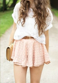 White crochet tucked into flowy pink dotted mini, tanned leather belt, chain link purse, boho waves